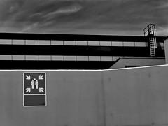 vanishing point & escape route (heinzkren) Tags: building lines linien schwarzweis blackandwhite monochrome panasonic piktogramm pictogram feuerleiter mauer wall gebäude urban notausstieg notausgang fluchtpunkt sicherheit savety point flucht flight schild sign vanishingpoint