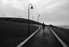 (cherco) Tags: solitary solitario silhouette shadow silueta street sombra sea mar lantern lampara farola way sky cielo repetition composition composicion blackandwhite blancoynegro landscape grass reflexions lonely man hombre canon canoneos5diii