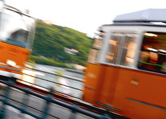 Tram Tram (roomman) Tags: 2017 hungary budapest trip walk walking street photography evening midsommar summer nice beuatifuk tram train transport transportation yellow cross two trams line stop lines hungarian rail rails railway railways mav vasútállomá station load loading blur blurry speed velocity