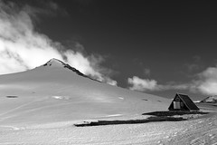 Mountain and refuge - Black serie #1 (Edward Newman Photography) Tags: mountain landscape snæfellsjökull iceland refuge clouds snow contrast blackandwhite fog mist house home nature sky islandia black dark