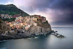 Little Boxes Above A Sea Of Dreams. (Andy Bracey -) Tags: bracey andybracey italy manarola cinqueterre cliff rocks coast coastal port harbour marina marinapiccola landscape seascape nikon d200 feefilters bigstopper motionblur smooth sea water boats cloudy morning sunrise holiday ligurian liguriansea hilltop houses trekking goodtimes perfect aseaofdreams littleboxes littleboxesaboveaseaofdreams