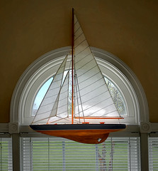 Circle window sailboat (SteveMather) Tags: half window model sailboat shade curtain shading smartphotoeditor procamera iphone 6s residential architecture furnishings decorations