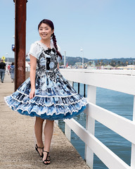 Mary twirling her dress (Tex Texin) Tags: santacruz mary wharf pier blue jellyfish dress braids