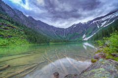 Trickle Down (clarkschiring) Tags: glacier overcast landscape avalanche lake clear water dramatic sky montana