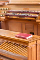 A Red Book, Read (DaveLawler) Tags: red book bench pipe organ keys keyboard pedals pedalboard hymnal church massachusetts wooden auburn nikon nikkor