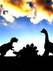 dinosaurs....Macro Monday.... silhouette (ladybugdiscovery) Tags: silhouette dinosaurs trex brontosaurus stegosaurus sky clouds macromonday