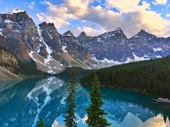 On the rockpile - iPhone (Jim Nix / Nomadic Pursuits) Tags: iphone snapseed travel alberta canada banff morainelake sunset goldenhour jimnix mountains lake alpine glacial glacier clouds reflections