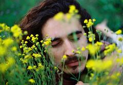 Never be ashamed of yourself. (Hijo de la Tierra.) Tags: film analog 35mm grain spring nature portrait boy longhair hijodelatierra agustíngaleano flowers hippie sonoftheearth