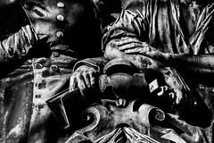 (C-47 [Offline]) Tags: 400d steel madeofsteel bw monochrome mono moment shadows light focus zoom noiretblanc noirblanc details handsart hand statues architecture 18200mm