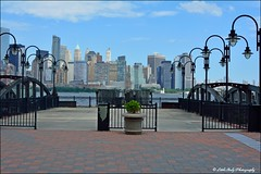 Liberty State Park Pier and the Manhattan Skyline (Little Italy Photography) Tags: nikond7100 nikon newyorkcity newyork bigapple manhattan nikon18105mmf3556gedifafsvrnikkorzoomlens nikon70300mmf4556gedifafsvrzoom nikonafsdxnikkor35mmf18glens nationalregisterofhistoricplaces streetlamps lamps eastriver worldtradecenter financialdistrict sunset clouds fair cloudy clear architecture historicbuildings 911 911memorial reflectingpools memorials worldtradecentersite buildings skyscrapers haze travel usa avenues clock centralpark columbuscircle centralparkwest grandcentralstation trainstation day night