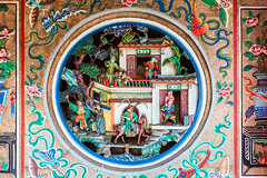 Beautiful decorations on the wall of a Chinese temple (Evgeny Ermakov) Tags: asia asian china chinese georgetown malaysia penang ancient antique architecture art closeup colorful colors culture decoration old oriental ornament ornate religion religious sculpture symbol temple tourism touristic traditional travel typical vibrant wall