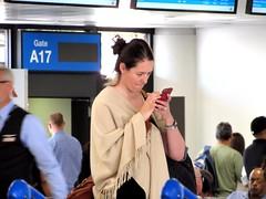 Wireless world (thomasgorman1) Tags: cellphone wireless parson people woman airport phoenix arizona