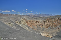Ubehebe Crater with Desert and Moun (taharaja) Tags: cactus california deathvalley desert furnacecreek ghosttown jeeping lowestpoint nationalpark offroad oldtown racetrack sealevel zabriskiepoint lakebed movingstones slatflats