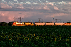 A Glint of the Past (Wheelnrail) Tags: bnsf atsf locomotive ge emd rail road railroad train trains freight lchi101 local chicago illinois rails chillicothe subdivision burlington northern santa fe sunset light clouds pink warbonnet