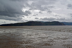 grey skys (Lord Edam) Tags: sea coast coastline beach river sand rocks llandudno conwy clouds waves mountains groyne kite surfing kitesurfing actionsports