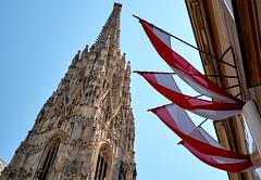 Unmistakably Vienna (ggppix) Tags: vienna wien warm tone ststephan's church kirche cathedral domkirche ststephan archibishop erzbischof spire turm turmspitze steeple kirchturm stephansplatz austria österreich flag dieflagge banner bundeshauptstadt red rot white weiss unicredit bank