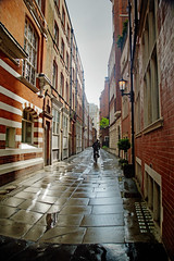 "London Alley (jimj0will) Tags: lewishamstreet london wet rainy rain weather buildings bike bicycle backlit reflected reflections lines converging""vanishingpoint"" perspectivepuddle redbrick ""gaslamp"" ""redbrick"" ""lewishamstreet"""