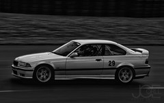 Final Bend (Joseph Corll) Tags: bmw 1995 pittsburgh international raceway intl race way pgh 95 black white bw monochrome watermark watertag fast zoom racing time trial beaver run water mark tag
