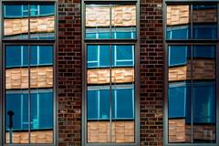 The other side (Maerten Prins) Tags: germany duitsland hamburg window windows reflection mirror glass distortion gold skew bricks