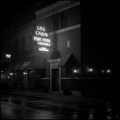 Fine Food and Cocktails (argentography) Tags: yashica 124 galena illinois midwest ilford hp5 noir blackandwhite monochrome logcabin steakhouse sinatra neon film night