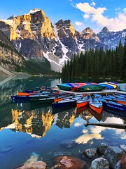 Canoes at rest - iPhone (Jim Nix / Nomadic Pursuits) Tags: iphone snapseed travel alberta canada morainelake lakelouise canadianrockies mountains sunset prohdr jimnix nomadicpursuits lake canoe canoes beautiful goldenhour colorful