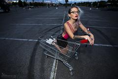 Latex shopping with Emily (kemafoto.hu) Tags: supermarket woman sexy fetish heels hotlatex pleaser shoppingcart kemafoto inkedtattoo septum pierced seminude glasses