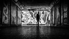 draw (Daz Smith) Tags: chosen dazsmith fujixt20 fuji xt20 andwhite bath city streetphotography people candid portrait citylife thecity urban streets uk monochrome blancoynegro blackandwhite mono silhouette man speed blur moving tunnel subway graffiti mural