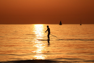 SUP Surfer & sailboats in a golden sea - Tel-Aviv beach