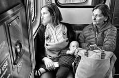 Family on a Train (draketoulouse) Tags: chicago brown line cta street streetphotography people child baby blackandwhite monochrome subway train mother grandmother window eyecontact