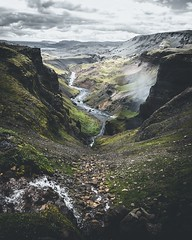 Looking out a beautiful valley in Iceland. Tiny person for scale on the left. (thrainnk) Tags: canyon landscape olympus iceland river moody tones clouds nature waterfall em5 olympusem5 photography nordic europe hobbit lordoftherings valley