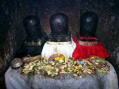ubud_204 (OurTravelPics.com) Tags: ubud trilinga statues with offerings elephant cave goa gajah temple
