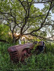 In the Weeds (burntpixel.ca) Tags: canada manitoba photo photograph rural fine art patrick mcneill burntpixel wrench777 beautiful spectacular canon 6d canon6d landscape vertical nature sunrise sunset evening morning tractor panorama branches trees grass brown green rust forgotten abandoned decay ruin automobile machine history old