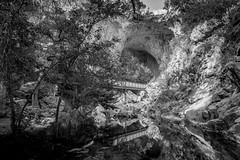 Tonto Natural Bridge is a natural arch (Eve Photography By JC Clemens) Tags: tonto natural bridge arch arizona pine payson nikon bw black white state park landscape landmark tamron water tree