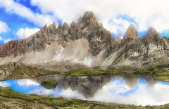 Dolomiti (Gio_ said_good_by) Tags: dolomiti dolomites dolomiten landscape mountainscape landscapes italy mountain clouds sky reflections atmosphere wind blue azul nuvole riflesso lago trecime