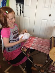 Considering weft choices. (wovenflame) Tags: weaving saori handwoven pink granddaughter child