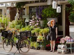 Waiting..... (Thea Teijgeler) Tags: amsterdam flowers bike girl fiets bloemen