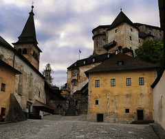 The quiet courtyard of the Orava Castle after the last tour of the day (B℮n) Tags: oravský hrad castle orava plteoravask oravskýpodzámok rafting down river floating slovakia slowakije nature rock oravské múzeum building tower lower upper entrance gates fotification tunnel history settlement site fort constructed tartar invasion cliffs tourist holiday gothic styles romanesque reconstructed renaissance neogothic old palace dungeon orawskie zamki zilinsky 1241 anno kasteel views unique proud archaeological exposition county rocks burnt impressive church chapel lion sculpture dragon stone statue courtyard last tour quiet fortifications 50faves topf50 100faves topf100