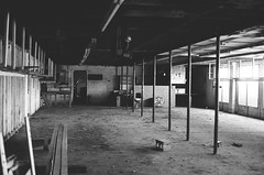Abandoned (Gabby Pike) Tags: abandoned building urban decay old aged weathered bnw monochrome black white film analog photography analogue kodak tmax 400 canon ae1 no person