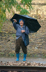 A friendly wave (Frühtau) Tags: dprk north korea asia asian old woman elderly people leute nordkorea korean frau wave wink daily life scene rural area country side farmer bauer land umbrella schirm chaoxian
