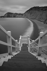 Jacob's Ladder, Sidmouth, Devon (Jacob Kenworthy) Tags: devon sidmouth nikon monochrome movement motion moody bw blackandwhite beach blur landscape light le longexposure ladder jacobsladder seascape
