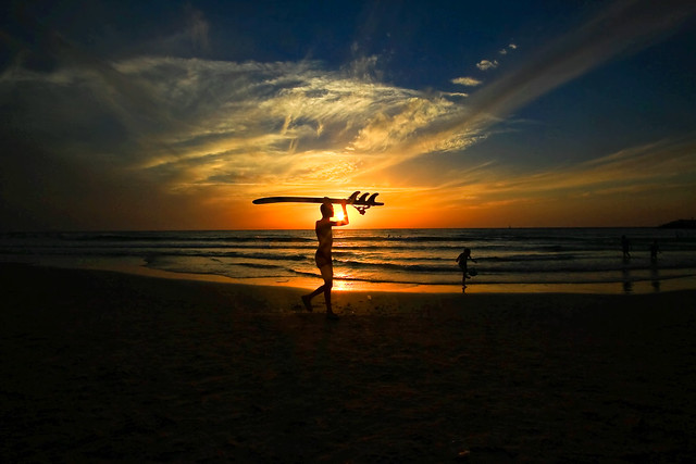 Surfer at sunset -Tel-Aviv beach