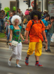 colorful couple (try...error) Tags: gay pride wien vienne vienna street man woman yellow gelb rot orange red regenbogenparade 2017
