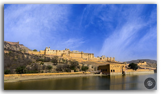 The beauty of golden Amer fort in the bright summer sky!