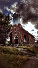 silence on the hill... (BillsExplorations) Tags: slide sliderssunday hss abandoned decay closed shuttered church abandonedchurch abandonediowa darkskies clouds sky dark presbyterian faith religion centerjunction forgotten old brick hill silence