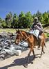 Getting home a bag of maize (Hans van der Boom) Tags: holiday vacation southafrica lesotho zuidafrika semonkong maseru animal horse man rider bag maize mealiepap lso