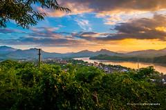 Sunset of Luang Prabang (reubenteo) Tags: sunset laos luangprabang mekong river mountain hill cloud sun sunlight twilight bluehour goldenhour riverfront asia southeastasia boat travel vacation quiet tranquil blue warm orange phousi