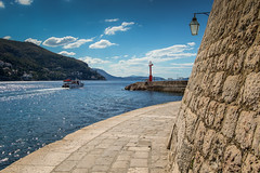 Dubrovnik Harbour (the CAMera of ian CAMpbell; simple) Tags: dubrovnik sea sky harbour water boat pave pavement wall fort hill