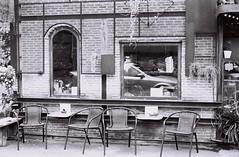 Ekkamai - Bangkok (35mm) (jcbkk1956) Tags: bangkok thailand street ekkamai film 35mm coffeeshop cafe ilford pan100 contax 167mt mono blackwhite carlzeiss 45mmf28 manualfocus analog tables chairs furniture worldtrekker