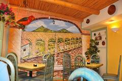 1-019 El Sombrero Interior (megatti) Tags: desert elsombrero mural newmexican newmexico nm restaurant socorro tables