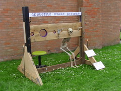 Skeleton pillory (Nekoglyph) Tags: appletonwiske yorkshire village scarecrow festival 2017 summer pillory punishment wall bricks skeleton seat holes grass green